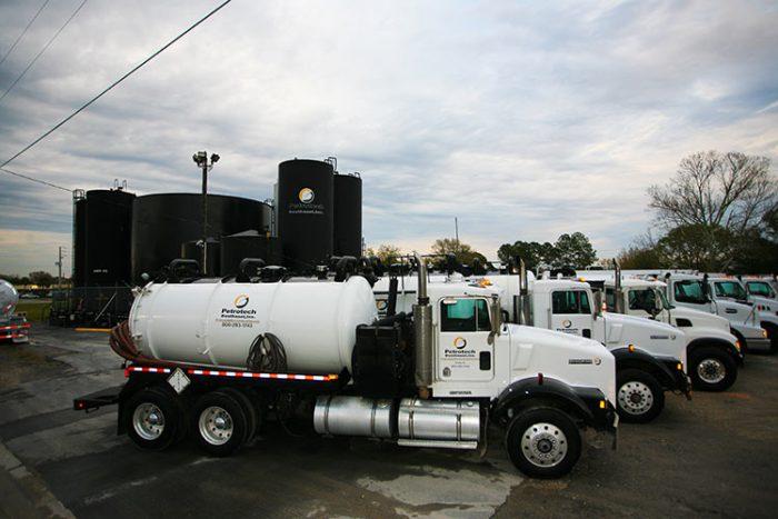 white trucks and black tanks