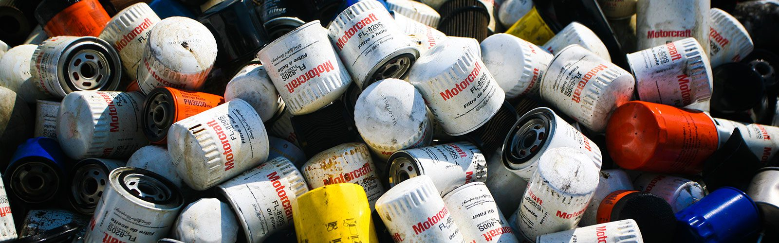 Pile of used oil cans