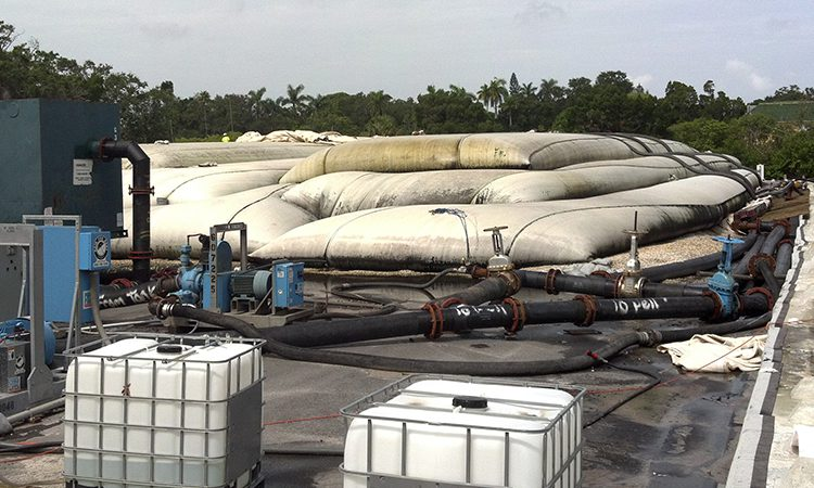 Storing water removed from industrial process pond